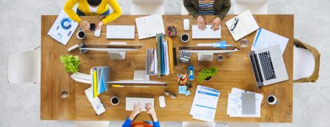 Employees at a desk